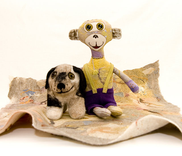 soft toys 'flying carpet'. Carpet and monkey are felt panels with hand embroidery machine stitching needle felting.